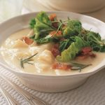 Celeriac soup with cabbage, bacon and herbs