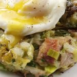 Leek and pulled ham bubble and squeak with a poached egg