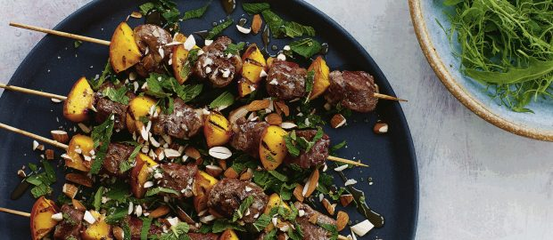 Goat kebabs with peaches, honey, almonds and mint